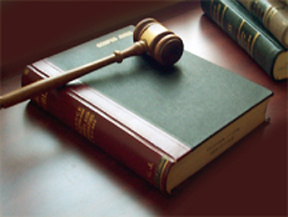 Image of a gavel on top of law books.